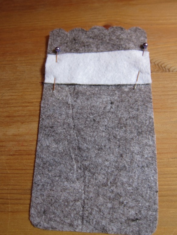 Sew white rectangle to the grey front cover