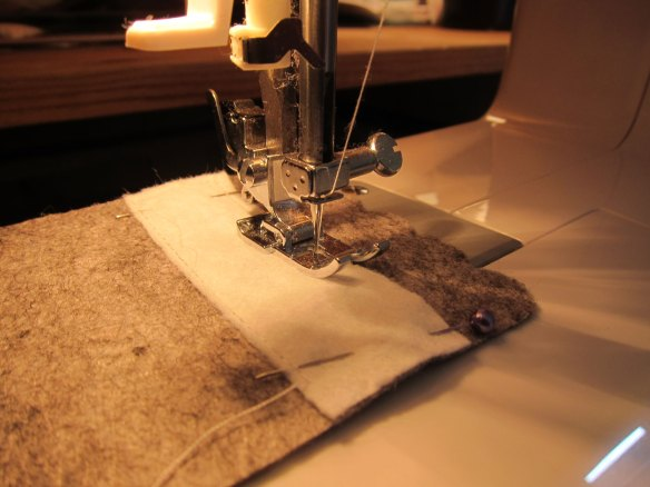 Sewing white rectangle to the grey front cover