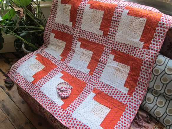 Finished log cabin baby quilt