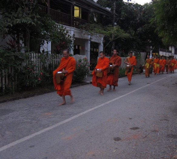 Monk procession through Luang Prabang
