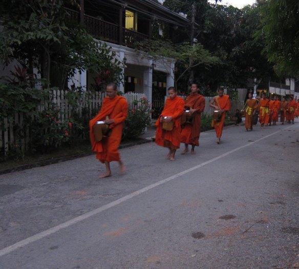 Monk procession through Luang Prabang